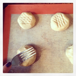 Press wet fork in a # pattern on the balls of #PeanutButterLoversDay cookie dough. Bake @ 375 for 10-12 minutes